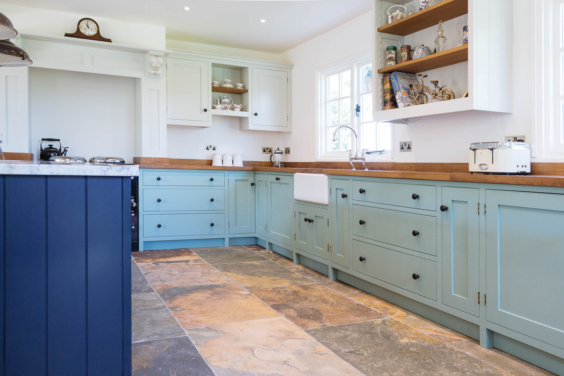Foxes Hill Kitchen detailing showing an antique brass Harlrech pull handle against Farrow & Ball Pitch Black paint